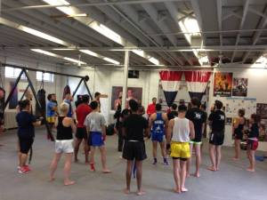 a local instructor gives a talk on Being a student: An approach to learning muay thai