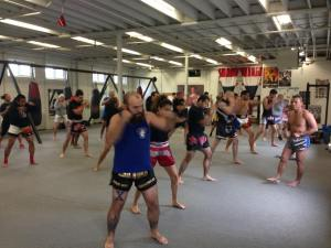 Master Suchart taking a group through the physical practice of traditional Muay Thai